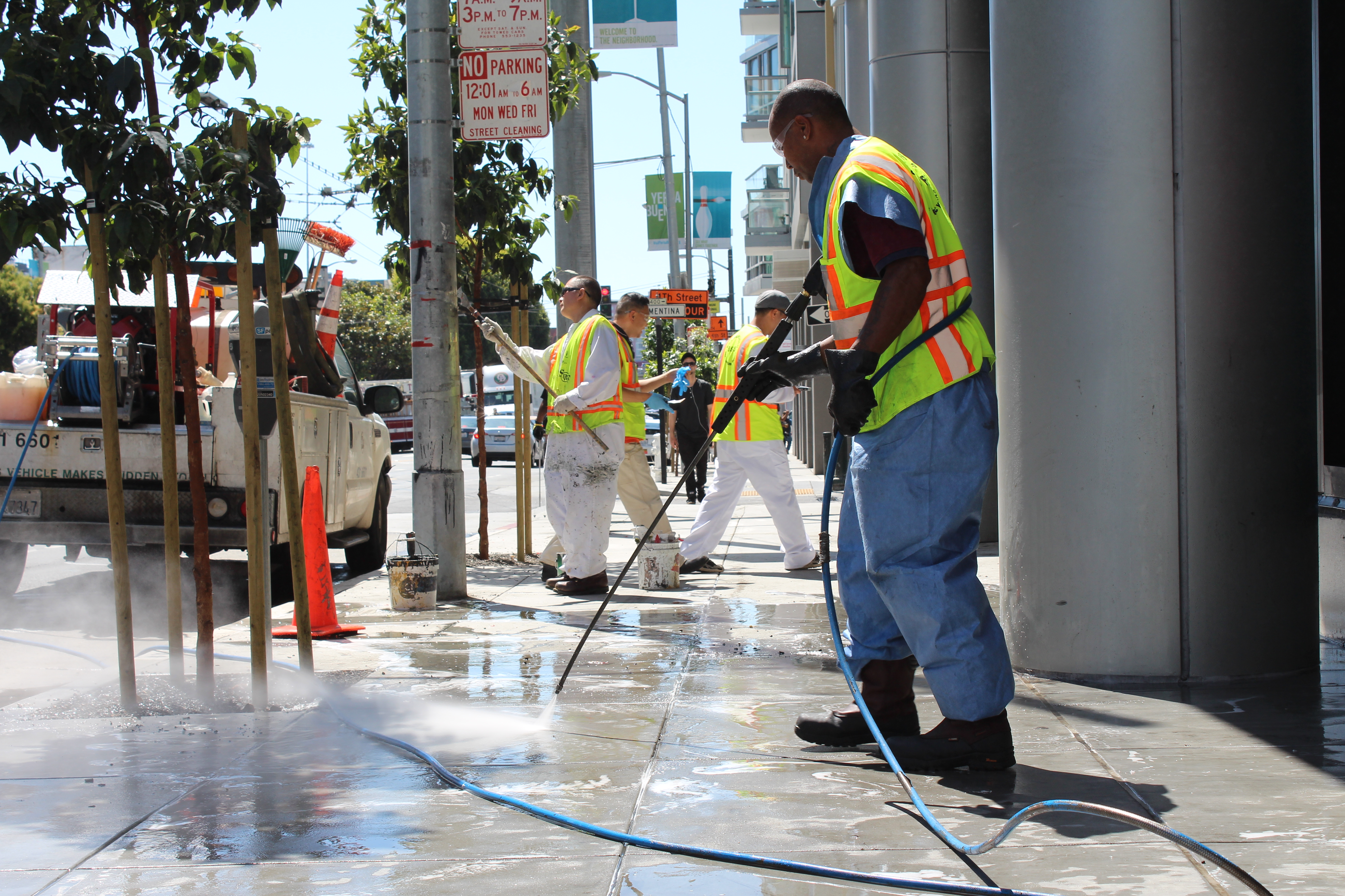 staff cleaning sidewalk during eco blitz