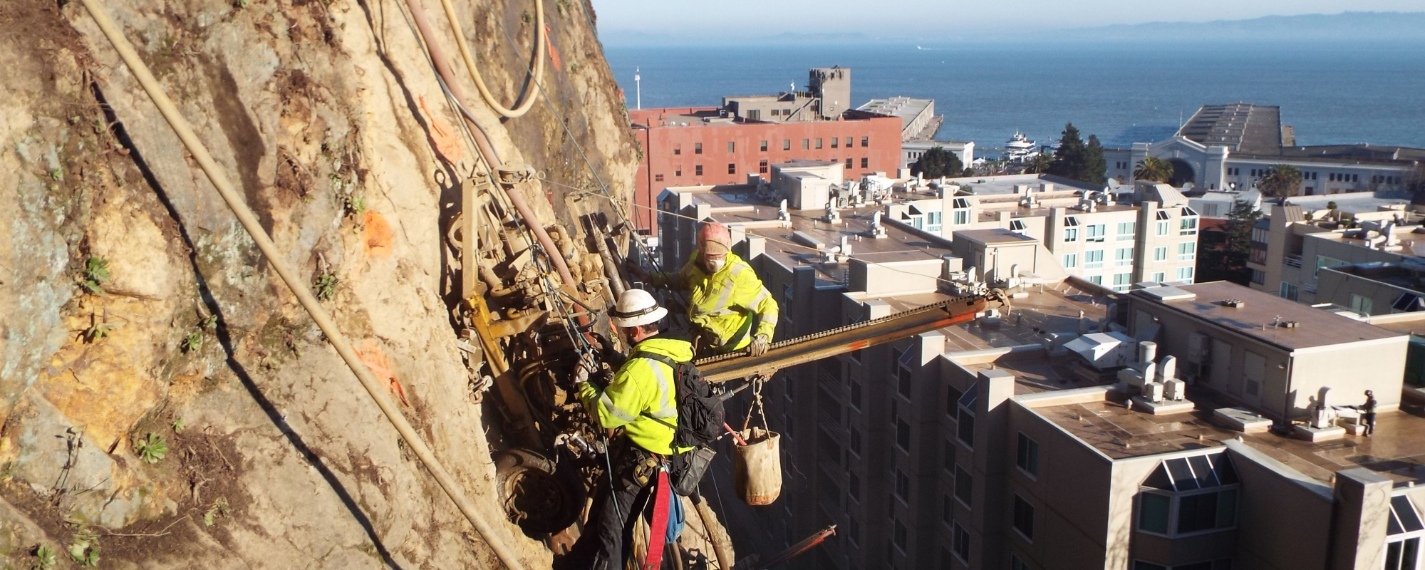 Workers suspended from the cliff of Telegraph Hill